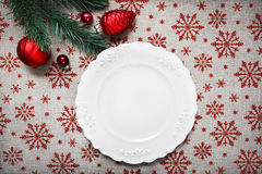 Vintage Christmas plate on holiday background with Red Christmas ornaments. Xmas card. Happy New Year Royalty Free Stock Photo