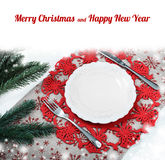 Vintage Christmas plate on holiday background with xmas tree. Canvas background with red glitter snowflakes. Xmas card. Happy New Royalty Free Stock Photos