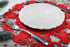 Vintage Christmas plate on holiday background with xmas tree. Canvas background with red glitter snowflakes. Xmas card. Happy New Royalty Free Stock Photo