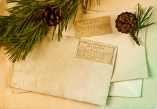 Vintage christmas postcard and envelope. With pine tree branch decoration. retro style toned picture Stock Photo