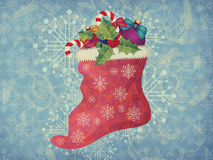 Vintage Christmas sock on blue background Royalty Free Stock Image