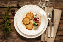 Vintage christmas table - white plate with ginger cookies from above Stock Images