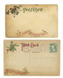 Vintage Christmas Theme Postcards. Two aging Christmas time postcards from 1910, isolated on white.  Both are blank and have clipping paths Stock Photo