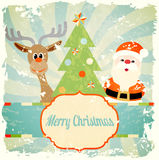 Vintage christmas theme with santa and reindeer Stock Image