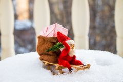 Vintage Christmas toys. Gnome in red cap on wooden sled among sn. Ow Royalty Free Stock Image