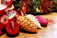 Vintage Christmas tree decorations lined up on a wooden surface. royalty free stock photo
