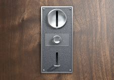 Vintage Chrome Coin Receptacle. A vintage metal coin receptacle slot panel from a coin operated machine with entry and exit slots mounted on a wooden surface royalty free illustration