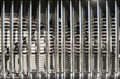 Vintage chromed vehicle grille. Closeup abstract of a vintage chromed vehicle grille Royalty Free Stock Images