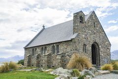 Vintage church in Tekapo lake New Zealand with cloudy sky Royalty Free Stock Photography