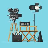 Vintage cinema concept. Movie camera with film reels, director chair, searchlight, megaphone and clapperboard. Vintage cinema concept. Vector illustration in Royalty Free Stock Images