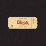 Vintage cinema ticket over grunge background. Concrete texture. Stock Photos