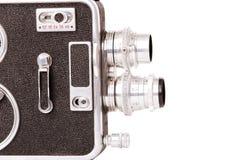 Vintage cinematography. Old retro camera isolated on white background royalty free stock photo