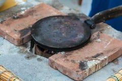 Vintage Circular Cooking Plate between Two Orange Tiles royalty free stock images