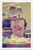 Vintage Circus Baby Shower Treats. Cupcakes, popcorn, peppermint candies and blue carnival tickets...all perfect for your vintage carnival baby shower or party Stock Photo
