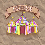 Vintage circus tent on folded paper background Stock Photos