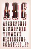 Vintage Circus And Western ABC Font. Illustration of a set of retro circus abc typefont, with letters, numbers, currencies and special characters on vintage and Stock Photo