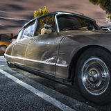 Vintage Citroen DS. Brown Citroen DS car parked on a suburban street at night Stock Photo
