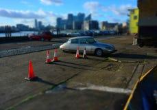 Vintage Citroen parked car. Cityscape Stock Photo