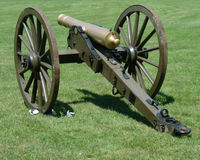 Vintage civil war canon two. Bronze civil war canon pointing to the left Royalty Free Stock Image