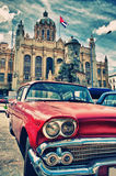 Vintage classic american car in a street of Old Havana. With Presidential Palace building in the background Stock Image