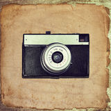 Vintage classic camera on old grunge paper Royalty Free Stock Image