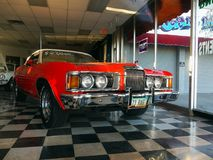 Vintage Classic Car, Mercury Cougar, Kingman Store. 1973, Mercury Cougar convertible red white top car. Vintage classic cars inside Cars Store in Kingman Arizona stock image
