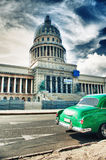 Vintage classic car parked in front of the Capitolio building Royalty Free Stock Photo