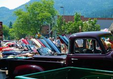Vintage Classic Car Show Crowds. Streets of Issaquah Washington lined with refurbished classic cars for annual Fathers Day Fenders on Front Street Royalty Free Stock Photography