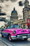 Vintage classic car in a street of Old Havana with Capitol in th Stock Images