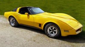 Chevrolet Corvette, Sports Car. Yellow Chevrolet Corvette car, side view. Vintage sports car stock image