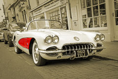 Vintage classic chevrolet corvette sepia. Photo of a vintage chevrolet corvette C1 classic showing wing panel detail and white wall tyres taken 18th april 2017 royalty free stock images
