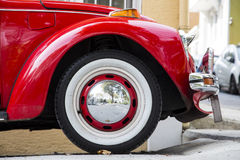 Vintage classic old VW Beatle car side view closeup. Vintage classic old Red VW Beatle car side view closeup Royalty Free Stock Images