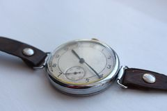 Vintage classic pocket watch closeup on white background. Time and dial background. Old retro clock. Vintage design wristwatch Royalty Free Stock Photo