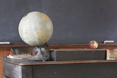Vintage Classroom with Antique Desk and Blackboard Stock Image