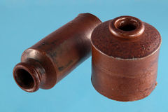 Vintage clay ink wells. On a blue background Stock Photos