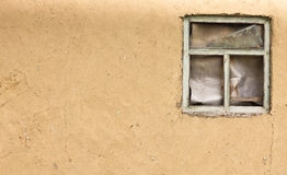 Vintage clay texture old wall with a window(0).jpg Royalty Free Stock Image