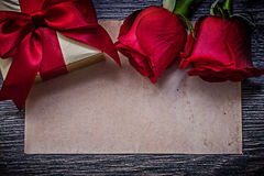 Vintage clean paper red bloomed roses wrapped gift Royalty Free Stock Images