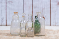 Vintage clear bottles grouped with one green bottle Royalty Free Stock Photo
