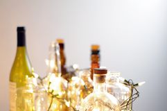 Vintage clear glass liquor bottles with Christmas lights. Calgary, Alberta, Canada Stock Image