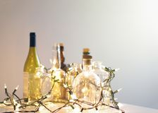 Vintage clear glass liquor bottles with Christmas lights Royalty Free Stock Photos