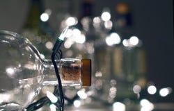 Vintage clear glass liquor bottles with Christmas lights. Calgary, Alberta, Canada Stock Photo