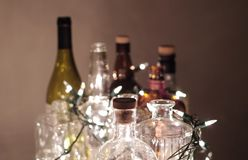 Vintage clear glass liquor bottles with Christmas lights Stock Photography