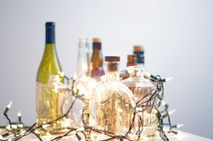 Vintage clear glass liquor bottles with Christmas lights Stock Image