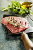 Vintage cleaver and Beef Carpaccio Royalty Free Stock Images