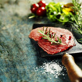 Vintage cleaver and Beef Carpaccio Royalty Free Stock Photography