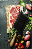 Vintage cleaver and raw beef steak Royalty Free Stock Photography