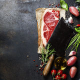 Vintage cleaver and raw beef steak Stock Photography
