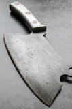 Vintage cleaver on stone table Stock Images