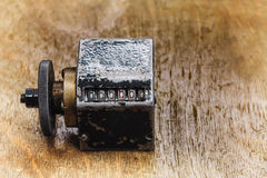 Vintage cliche stamp with number 666666. aged metal counter mechanism on wooden textured table. Calculation concept Stock Images