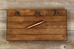 Vintage clipboard and metal pen on old wooden desktop Stock Photos